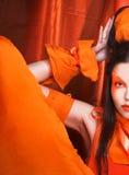 Orange flicka. Fotografering för Bildbyråer