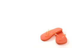 Orange Flip Flops. Orange flip-flop sandals against a white backdrop with room for text stock image