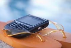 Orange Flip Flops And PDA Stock Image