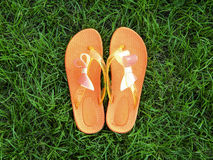 Orange flip flops with bow Stock Image