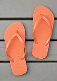 Orange Flip Flops on the Deck Royalty Free Stock Photography