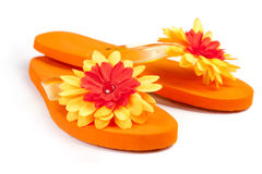 Orange flip-flops with flowers. On a white background royalty free stock photos