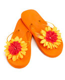 Orange flip-flops with flowers. On a white background Royalty Free Stock Photo