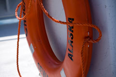 Orange Floatation Device on Boat in Alaska. A ring-shaped orange floatation device on a tour boat in Seward, Alaska Stock Photography
