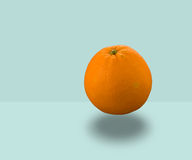 Orange Floating. On blue colored background Royalty Free Stock Photo