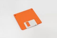Orange floppy disk Royalty Free Stock Photo
