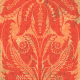 Orange floral damask. Graphics background with faint splashes of green throughout Stock Image