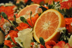 Orange and flower. Orange fruit and little flower Royalty Free Stock Photo