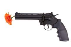 Orange flower hanging from the gun barrel Stock Photography