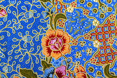 Orange flower pattern on batik royalty free stock photography