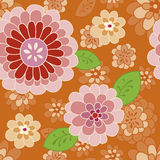 Orange flower pattern | Vector seamless background. Frolic large floral on orange background. Vintage inspired beige, pink and red flowers. A very whimsical and Royalty Free Stock Images