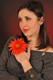 Orange flowers. Portrait of a young woman with a flower Royalty Free Stock Photography