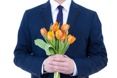 Orange flowers in male hands isolated on white Royalty Free Stock Photos