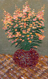 Orange flowers in a round vase Royalty Free Stock Image