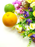 Orange & flowers on a white background. Fresh Orange & flowers on a white background Royalty Free Stock Photography