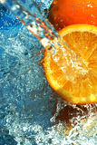 Orange flows water Royalty Free Stock Images
