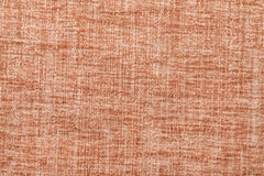 Orange fluffy background of soft, fleecy cloth. Texture of textile closeup. Stock Images