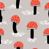 Orange fly agaric mushroom seamless pattern on greyish background. Cartoon repeat vector texture, great for packaging, fabrics, textile, home decor, wallpaper royalty free illustration