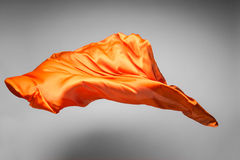 Orange flying fabric Stock Photos