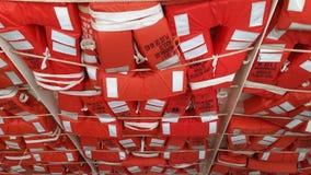 Orange flytvästar på en färja Royaltyfria Foton