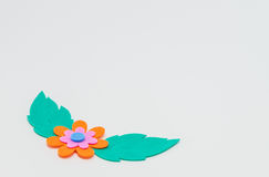 Orange foam craft flower with green leaf on white background and selective focus Stock Image