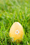 Orange easter egg sitting in the grass Royalty Free Stock Images
