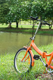 Orange folding bicycles in park Royalty Free Stock Photography