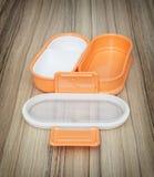 Orange folding plastic food box, kitchen equipment Royalty Free Stock Photos