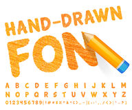 Orange font drawn with highly detailed orange pencil Stock Photography