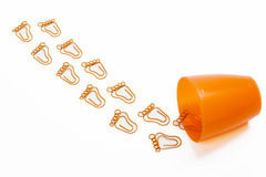 Orange foot shape paper clip Stock Photography