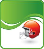 Orange football helmet. On a green wave background Stock Images