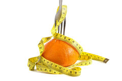 Orange and fork. Dieting concept Stock Photos