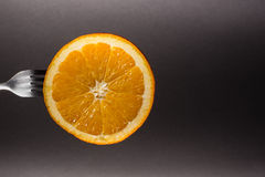 Orange on a fork Royalty Free Stock Photos