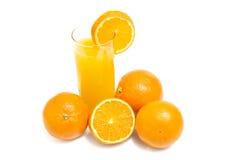 Orange frais et verre de jus Photos libres de droits