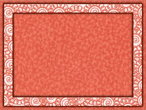 Orange frame with floral insert and paper background. Cardboard frame with motifs of flowers and paper background Stock Images