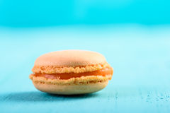Orange French Macaroon On Blue Stock Image