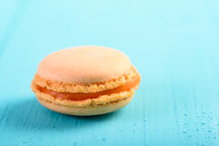 Orange French Macaroon On Blue Royalty Free Stock Photos