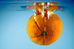 Orange 1. Fresh orange fruit splashing in water Royalty Free Stock Photo