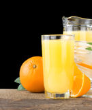 Orange fresh fruits and juice in glass on black Royalty Free Stock Images