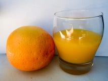 Orange. Fresh orange and orange juice in the glass Stock Image