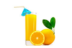 Orange fresh juice in glass with whole oranges with leaves and sliced orange isolated on white Royalty Free Stock Images