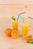 Orange fresh juice on wood table. Royalty Free Stock Images
