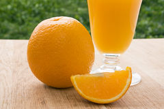 Orange and fresh orange juice Stock Photos