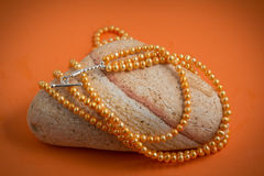 Orange freshwater pearl string Stock Photography