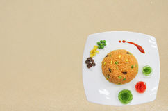 Orange fried rice decorate with vegetable Stock Photos