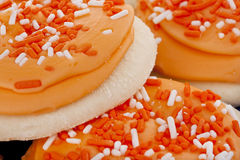 Orange Frosted Sugar Cookies with Sprinkles Stock Image