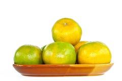 Orange Frucht auf dem Teller. Stockbilder