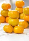 Orange Frucht auf Weiß Stockbilder