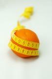 Orange Frucht mit Maß Lizenzfreie Stockfotografie