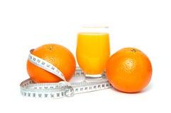 Orange Frucht und Saft mit Maßband Lizenzfreies Stockbild